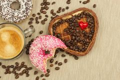 Fresh hot coffee and fresh donuts. Traditional sweets with coffee. Calorie junk food. Fresh unhealthy breakfast. Royalty Free Stock Photo