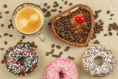 Fresh hot coffee and fresh donuts. Traditional sweets with coffee. Calorie junk food. Fresh unhealthy breakfast. Stock Photography