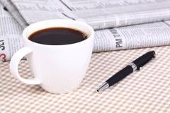 Fresh hot coffee on newspaper Royalty Free Stock Photos