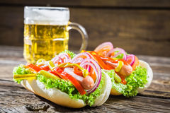 Fresh hot dog with sausage and vegetables Stock Image