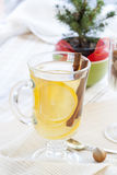 Fresh hot green tea in glass cup with lemon and cinnamon, chocolate cakes in basket and nuts and cinnamon Royalty Free Stock Photography