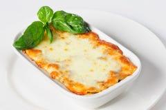 Fresh hot lasagna on white Stock Images