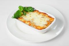 Fresh hot lasagna on white Royalty Free Stock Photos