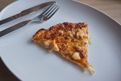 Fresh and hot Pizza slice for lunch.  royalty free stock photo