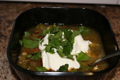 Fresh hot South American Aztec soup with cream. Also garnished with cilantro Stock Photography