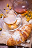 Fresh hot tea with croissant Stock Images