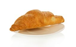 Fresh house croissant on a saucer Stock Photo