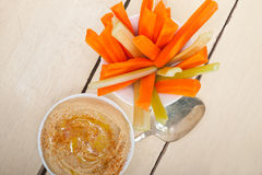Fresh hummus dip with raw carrot and celery Stock Image