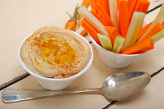 Fresh hummus dip with raw carrot and celery Stock Photos