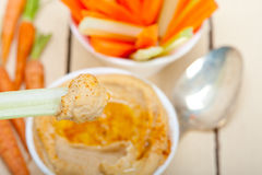 Fresh hummus dip with raw carrot and celery Royalty Free Stock Image
