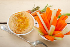 Fresh hummus dip with raw carrot and celery Royalty Free Stock Photos