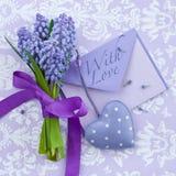 Fresh hyacinths and a heart Stock Photos