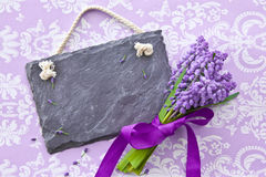 Fresh hyacinths and a slate chalkboard royalty free stock images