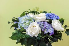 Fresh hydrangea and rose flower bouquet. With green leaves Stock Images
