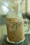 Fresh ice coffee in big glass with straw Royalty Free Stock Image