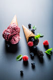 Fresh ice cream with berry fruits and mint leaves. On blackboard Stock Images