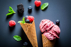Fresh ice cream with berry fruits in waffels. On blackboard Royalty Free Stock Photo