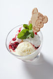 Fresh ice cream with jam in a glass bowl close up. royalty free stock images