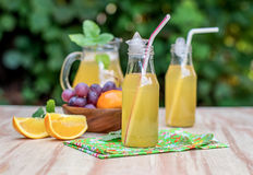 Fresh iced drinks with grapes and orange Stock Image