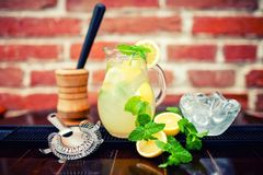 Fresh, iced mint lemonade in a jug with sliced lem Stock Image
