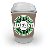 Fresh Ideas Coffee Cup Caffeine Fuels Creativity Imagination New. Fresh Ideas words on a coffee cup to illustrate new innovative concepts, inspiration Royalty Free Stock Photography
