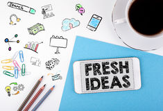 Fresh Ideas. Mobile phone and coffee cup on a white office desk Royalty Free Stock Images