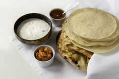 Fresh Indian flat breads Naans and poppadums Stock Photo