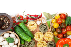 Fresh ingredients for cooking: pasta, tomato, cucumber, mushroom Royalty Free Stock Photos