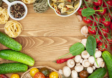 Fresh ingredients for cooking: pasta, tomato, cucumber, mushroom Royalty Free Stock Photography