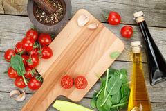 Fresh ingredients for cooking: pasta, tomato, salad and spices Stock Photos