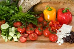 Fresh ingredients for greek salad. On a cutting board Royalty Free Stock Photography