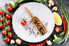 Fresh ingredients for healthy cooking. Cherry tomatoes, chive, b. Roccoli, mushrooms and hot peppers. Healthy eating and diet concept with copyspace Stock Photos