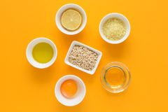 Fresh ingredients for homemade effective acne remedies on yellow background. Honey, sea salt, egg yolk, olive oil, oat, lemon and. Aloe. Flat lay. Copy space stock photos