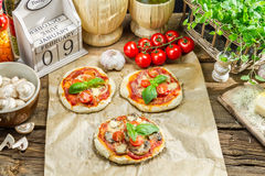 Fresh ingredients for a mini pizza Stock Photo