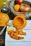 Fresh ingredients for pumpkin soep with apple, orange, carrot an Stock Photography