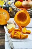 Fresh ingredients for pumpkin soep with apple, orange, carrot an Stock Photo