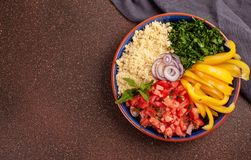 Fresh ingredients for salad with couscous. Healthy, vegeterian h. Fresh ingredients for tabbouleh salad: couscous, tomatoes, lemon, parsley, mint, olive oil stock images