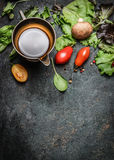 Fresh ingredients for salad making on rustic wooden background, top view Royalty Free Stock Images