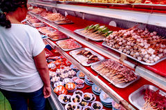 Fresh ingredients and seafoods in color dishes for making satay. stock photo