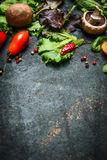 Fresh ingredients for tasty cooking and salad making on dark rustic background, top view. Frame Stock Photography