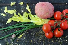 Fresh ingredients to prepare the meals. Tomatoes, potato, chives, celery and spices Stock Image