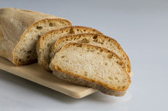 Fresh italian bread. Fresh bread sliced ​​on cutting board in plain sight stock photo