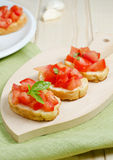 Fresh italian bruschetta. Bruschetta with tomato, garlic and basil Royalty Free Stock Photography