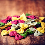 Fresh Italian Colourful Pasta on old wooden background close up. Stock Photos