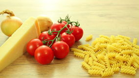 Fresh italian food ingredients on wooden table stock footage