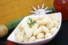 Fresh italian gnocchi. Some fresh italian gnocchi with rosemary in a bowl Stock Photos