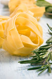 Fresh italian pasta. Pappardelle and rosemary royalty free stock photo