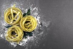 Fresh Italian pasta. On a dark background Stock Photo