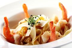 Fresh italian pasta served with shrimps Royalty Free Stock Image