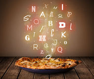 Fresh italian pizza with colorful letters on wood Royalty Free Stock Photography
